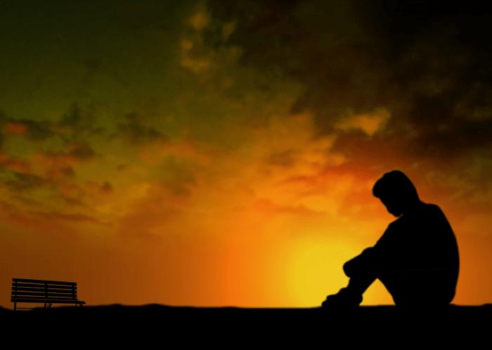 孤独でうずくまる人